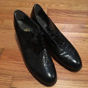vintage black leather heeled loafers